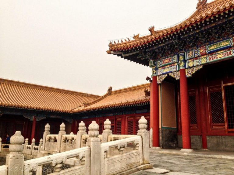 building and marble gate with intricate designs at forbidden city