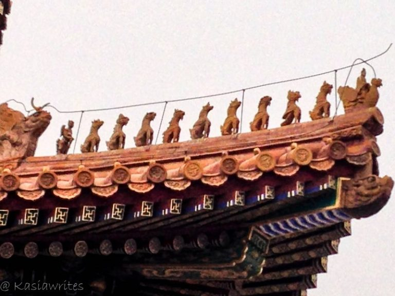 dragon statues on the roof of a building at the forbidden city beijing