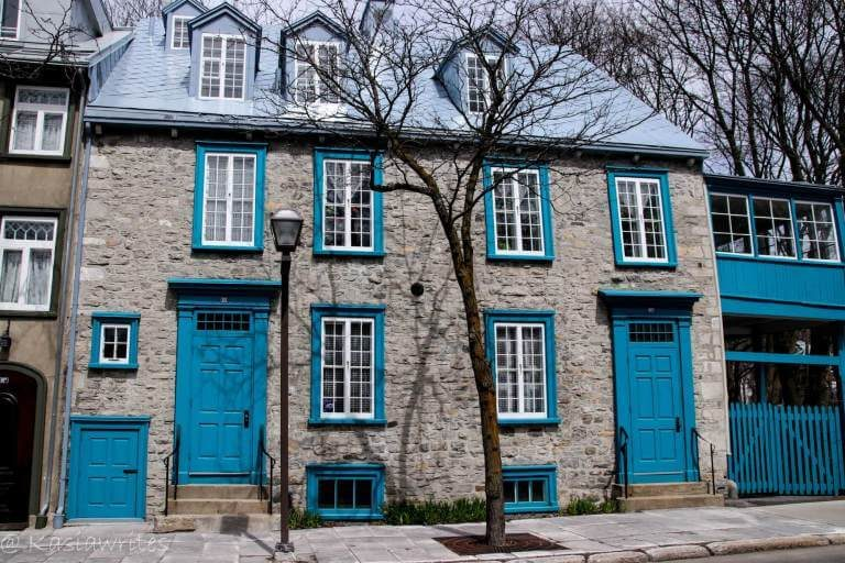 stone building with blue shutters
