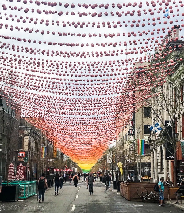balls hanging in between buildings to celebrate gay pride and a reason to fall in love with Montreal