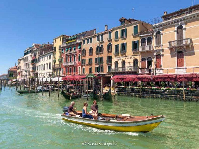 women on a boat in Venice