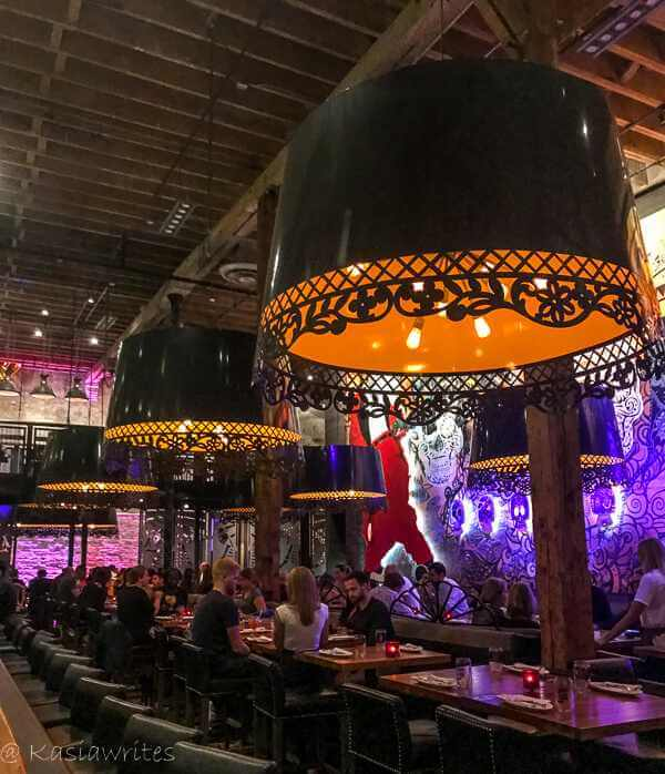 black chandeliers with glow in the dark paint on the wall
