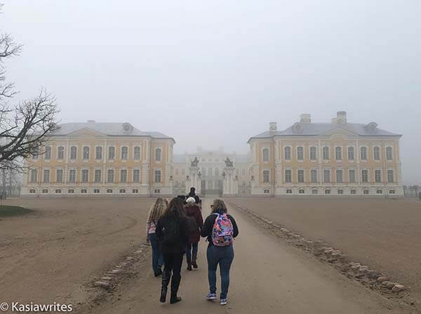 approaching the gates of Rundale Palace in Latvia on a foggy day