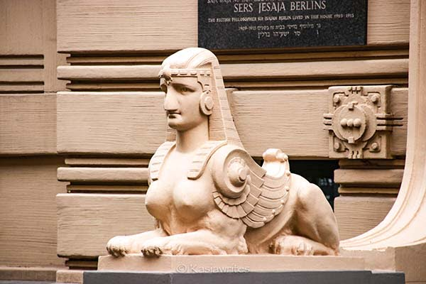 a statue of a breasted sphinx