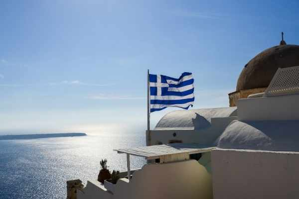 greek flag over the ocean