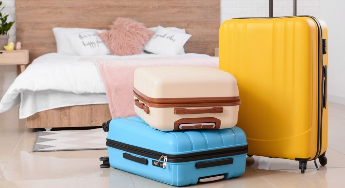 packed suitcases ready for revenge travel